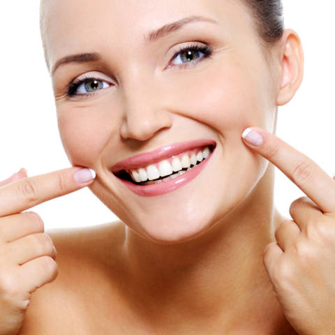 Beauty smiling fresh woman face with the health teeth